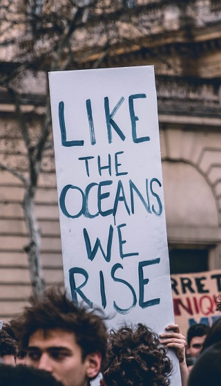 Climate change protesters making their point in this photo by Harrison Moore on Unsplash