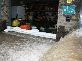 A small wall of FloodSax alternative sandbags prevented this torrent of floodwater from getting into a warehouse where it would have caused at least £360,000 damage