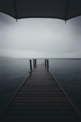 Rainy day looking out to sea. Photo by Alessio Lin on Unsplash website.