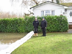 This barrier made from FloodSax alternative sandbags stopped water creeping up a garden