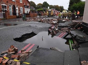 A fractured water mains ripped up this main road in Tipton, West Midlands