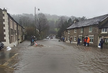 FloodSax protecting doors as water sweeps through the village of Whalley in Lancashire